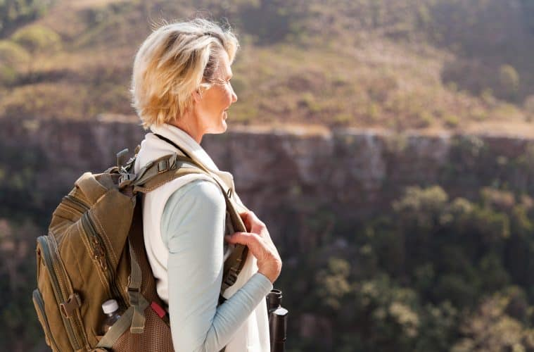 happy senior female hiker enjoying outdoor activity
