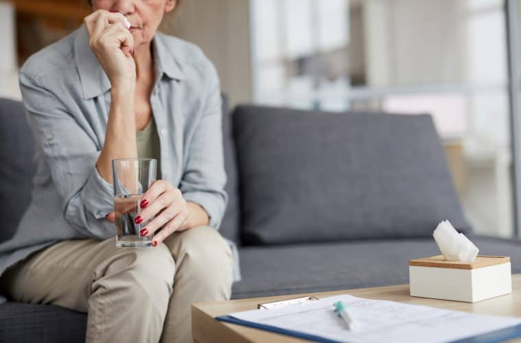 Anxious Mature Woman Drinking Water