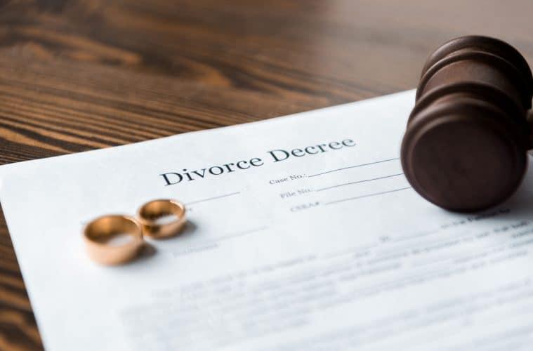 close up view of divorce decree wedding rings